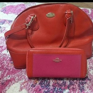 Red coach bag with wallet.